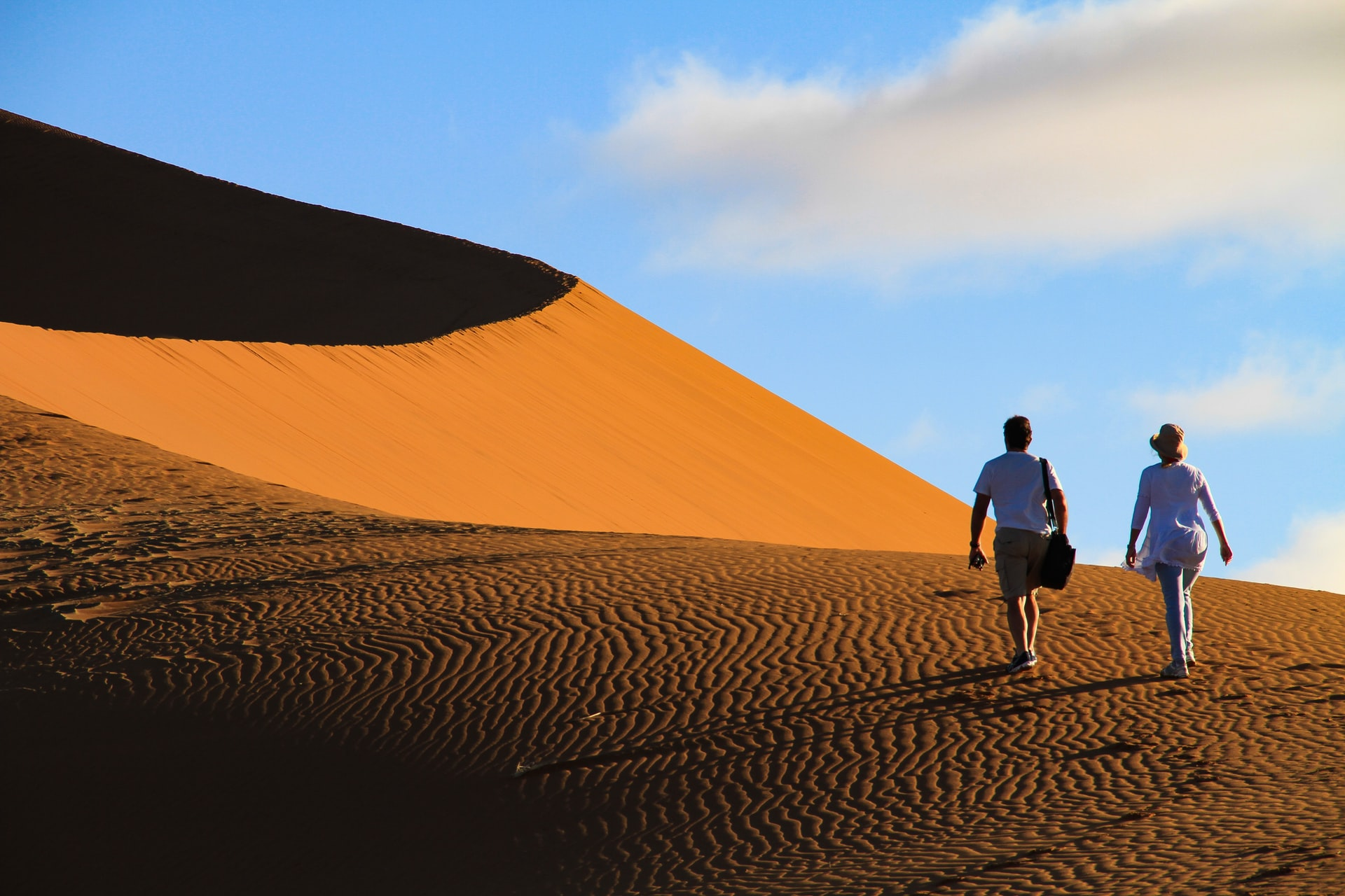 Walking in the dunes in morocco sahara desert- sahara desert camping - sahara desert activities